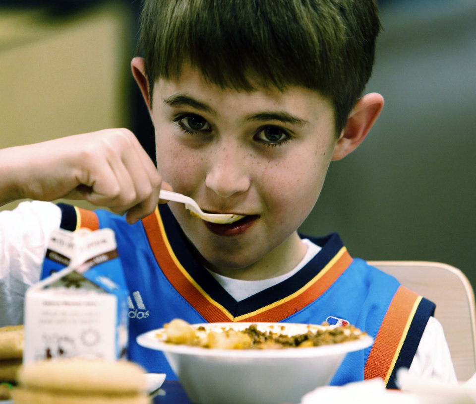 Roman Roberts, 9, eats a bowl of chili at the 38th annual Police and Fire Department Chili Supper benefiting the Christmas Store on Thursday, Jan. 9, 2014 in Norman, Okla.  Photo by Steve Sisney, The Oklahoman
