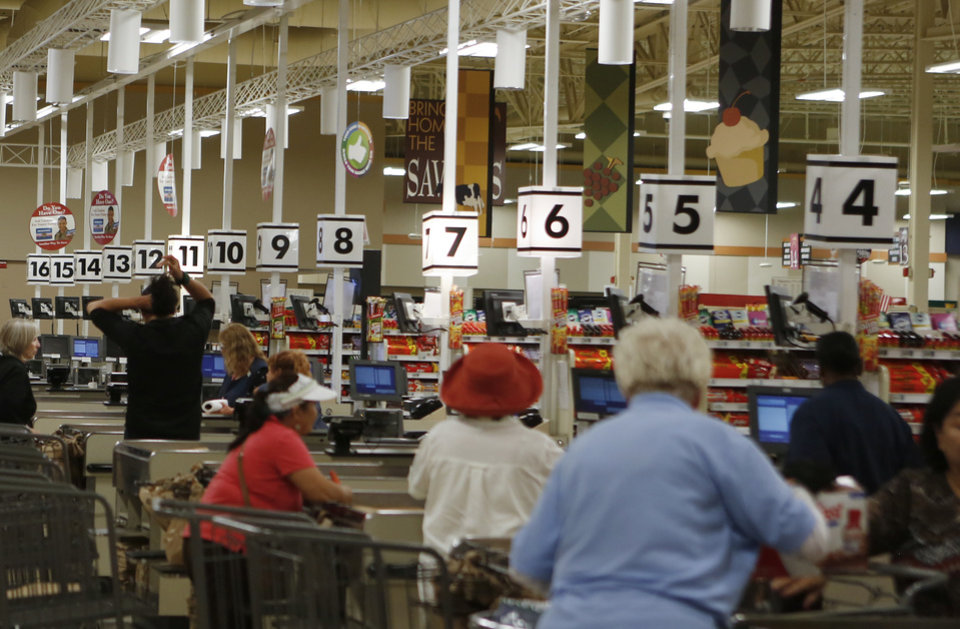 Photo -  People check out at the Commissary at Tinker Air Force Base. [Photo by Jacob Derichsweiler, The Oklahoman]