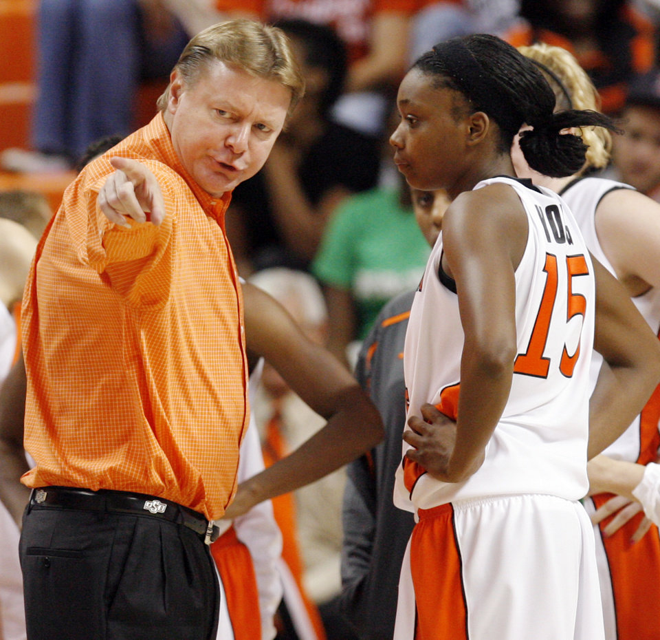 Photo - OSU head coach Kurt Budke talks to Toni Young (15) during the exhibition women's college basketball game between the Oklahoma State University Cowgirls and Washburn Lady Blues at Gallagher-Iba Arena in Stillwater, Okla., Tuesday, Nov. 10, 2009. Photo by Nate Billings, The Oklahoman