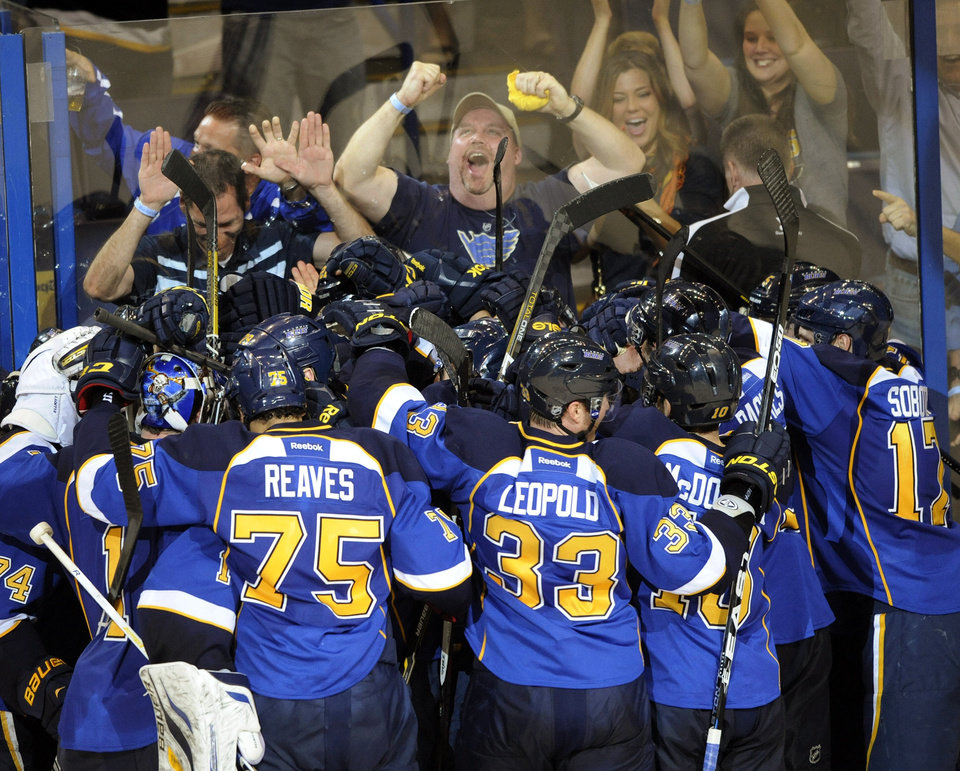 Photo - St. Louis Blues players celebrate their 2-1 overtime win over the Los Angeles Kings in Game 1 of their first-round NHL hockey Stanley Cup playoff series, Tuesday, April 30, 2013, in St. Louis. (AP Photo/Bill Boyce)