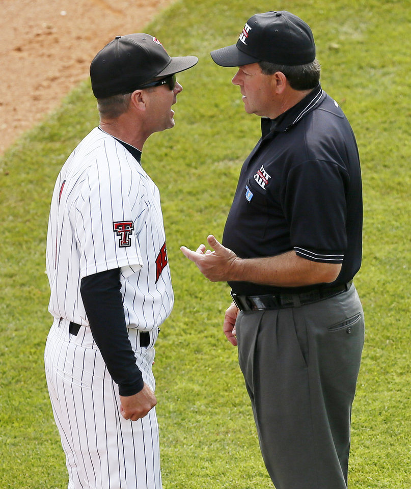 Photo - Texas Tech coach Tim Tadlock argues an interference call with 3rd-base umpire Randy Bruns in the 4th inning during an NCAA baseball game between Oklahoma and Texas Tech in the Big 12 Baseball Championship tournament at the Chickasaw Bricktown Ballpark in Oklahoma City, Friday, May 24, 2013. OU won 8-0. Photo by Nate Billings, The Oklahoman