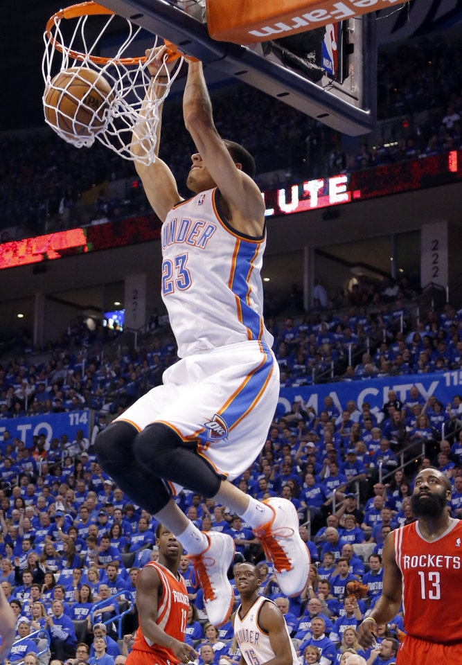 Photo - Oklahoma City's Kevin Martin (23) dunks the ball during Game 1 in the first round of the NBA playoffs between the Oklahoma City Thunder and the Houston Rockets at Chesapeake Energy Arena in Oklahoma City, Sunday, April 21, 2013. Photo by Sarah Phipps, The Oklahoman