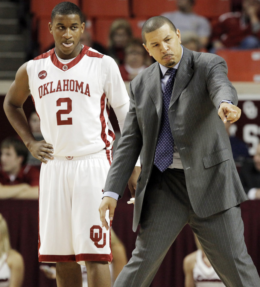 Photo - OU head coach Jeff Capel gives instructions to Steven Pledger (2) during the first half of the men's college basketball game between the Oklahoma Sooners and Louisiana-Monroe at Lloyd Noble Center in Norman, Okla., Tuesday, Nov. 17, 2009. Photo by Nate Billings, The Oklahoman