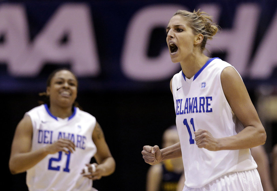 Photo - Delaware forward Elena Delle Donne, right, and guard Trumae Lucas react after Delle Donne scored and Drexel called a timeout during the second half of an NCAA college basketball game in the championship of the Colonial Athletic Association conference tournament in Upper Marlboro, Md., Sunday, March 17, 2013. Delle Donne scored a game-high 28 points to lead Delaware's 59-56 win. (AP Photo/Patrick Semansky)  Patrick Semansky