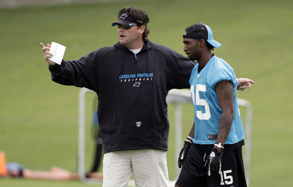 Photo -   Carolina Panthers' Joe Adams, right, listens to special teams coach Brian Murphy, left, during the NFL team's minicamp football practice for rookies and free agents in Charlotte, N.C., Saturday, May 12, 2012. (AP Photo/Chuck Burton)