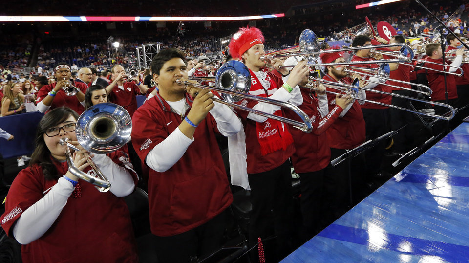 Photo - The OU band plays before the national semifinal between the Oklahoma Sooners (OU) and the Villanova Wildcats in the Final Four of the NCAA Men's Basketball Championship at NRG Stadium in Houston, Saturday, April 2, 2016. Photo by Nate Billings, The Oklahoman