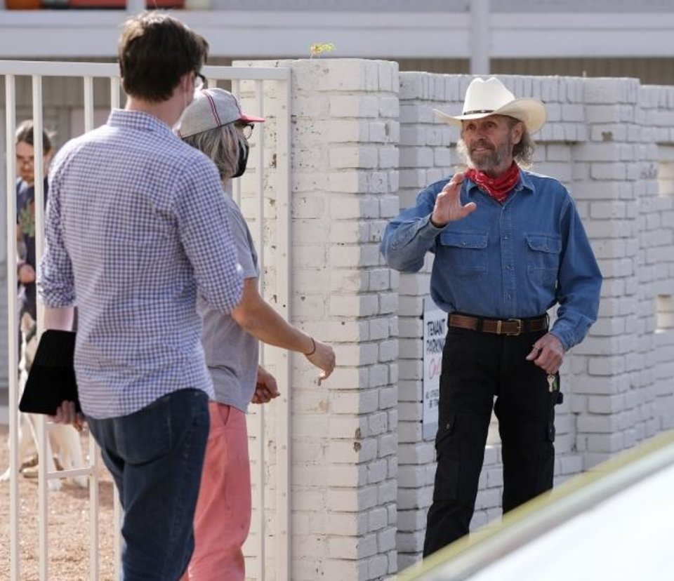 Photo -  Actor Luce Rains, right, talks on Oct. 15 to crew members on the set of the Oklahoma film