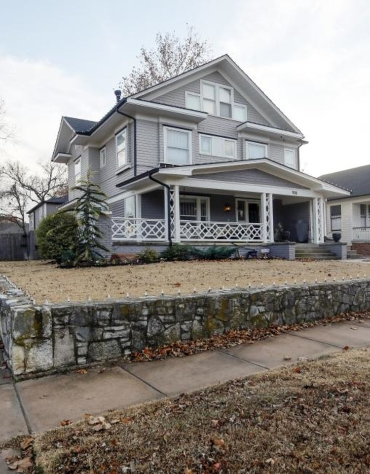 Photo -  Mat and McKenzie Clouse's American Foursquare-style house, 900 NW 20, built circa 1909, is a stop on the Mesta Park Holiday Home Tour. [NATE BILLINGS/THE OKLAHOMAN]