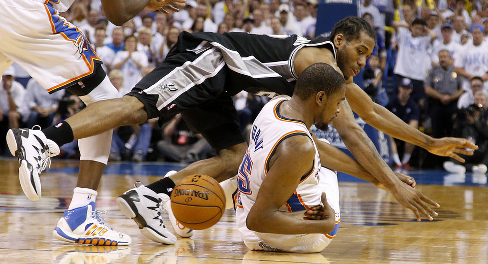 Photo - Oklahoma City's Kevin Durant (35) loses the ball under San Antonio's Kawhi Leonard (2) during Game 6 of the Western Conference Finals in the NBA playoffs between the Oklahoma City Thunder and the San Antonio Spurs at Chesapeake Energy Arena in Oklahoma City, Saturday, May 31, 2014. Oklahoma City lost 112-107. Photo by Bryan Terry, The Oklahoman