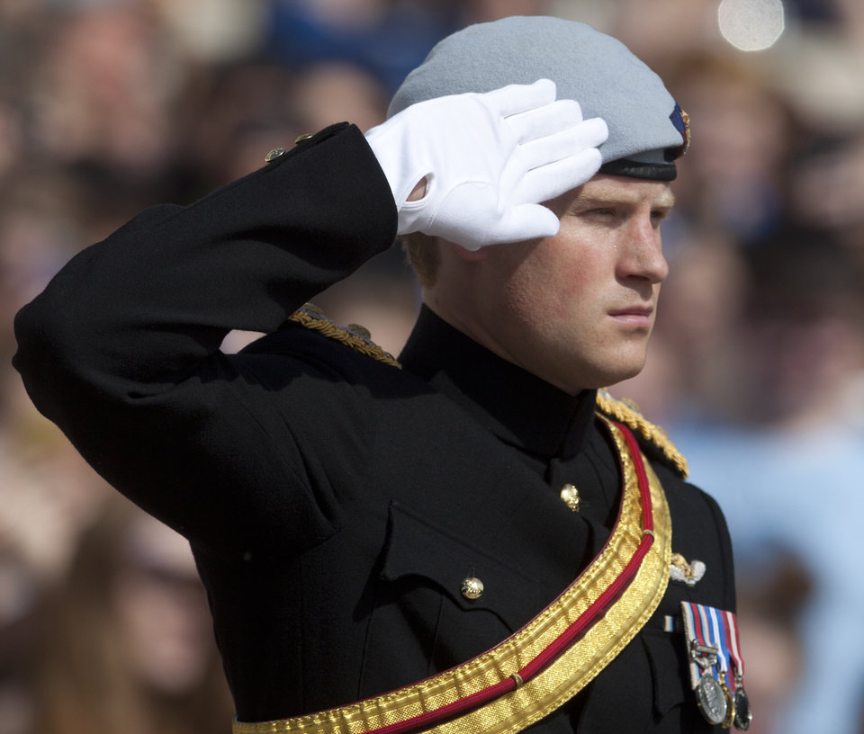 Photo - Prince Harry salutes during a wreath laying ceremony at the Tomb of the Unknowns at Arlington National Cemetery in Arlington, Va Friday, May 10, 2013. (AP Photo/Carolyn Kaster)