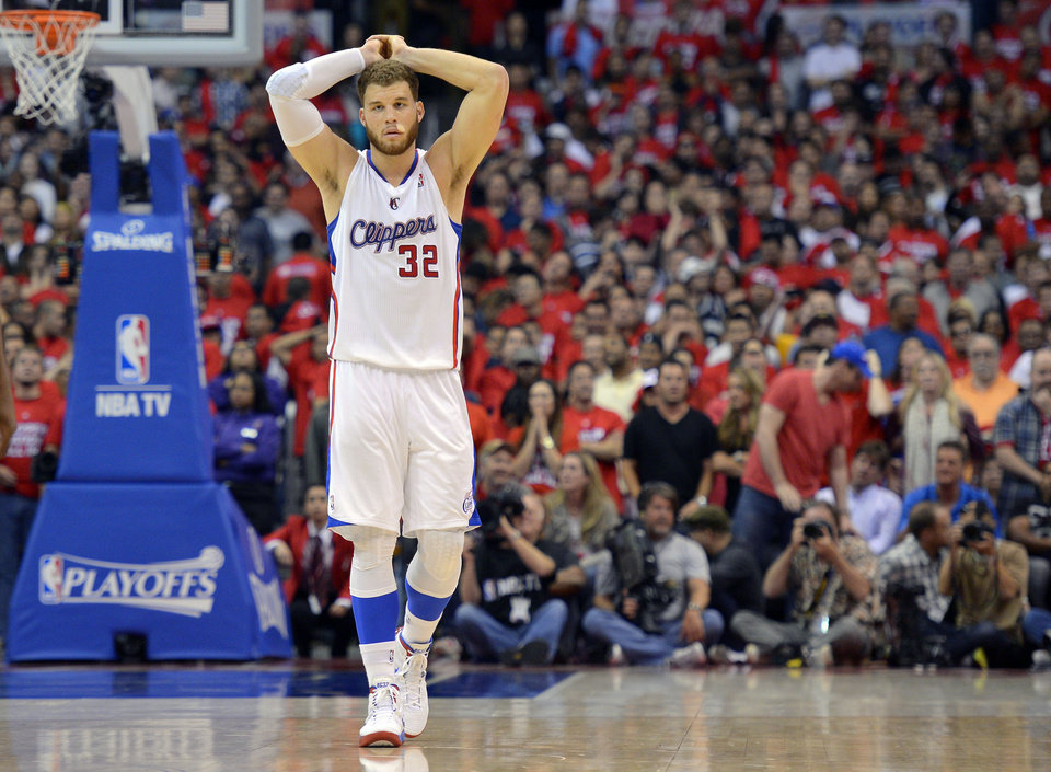 Photo -   Los Angeles Clippers forward Blake Griffin reacts in the final seconds of Game 4 of an NBA basketball playoffs Western Conference semifinal against the San Antonio Spurs, Sunday, May 20, 2012, in Los Angeles. The Spurs won 102-99. (AP Photo/Mark J. Terrill)