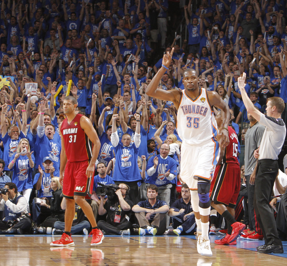 : Oklahoma City's Kevin Durant (35) reacts in front of Miami's Shane Battier after making a three-point shot during Game 1 of the NBA Finals between the Oklahoma City Thunder and the Miami Heat at Chesapeake Energy Arena in Oklahoma City, Tuesday, June 12, 2012. Photo by Chris Landsberger, The Oklahoman
