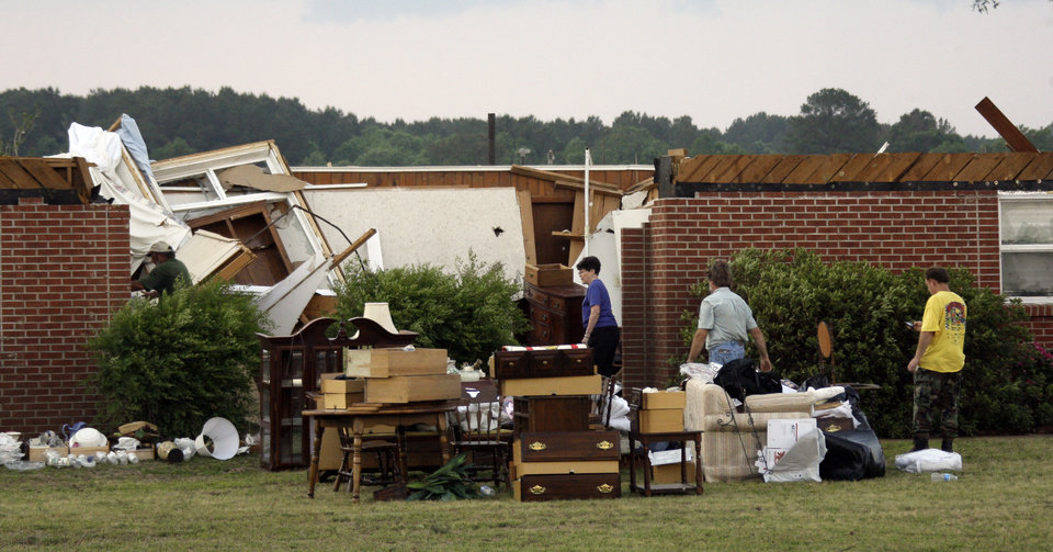 Photo - Residents remove their possessions from the remains of their tornado damaged home near Bond, Miss., Wednesday, April 27, 2011. Several tornadoes hit  in the state resulting in number of deaths. (AP Photo/Rogelio V. Solis)