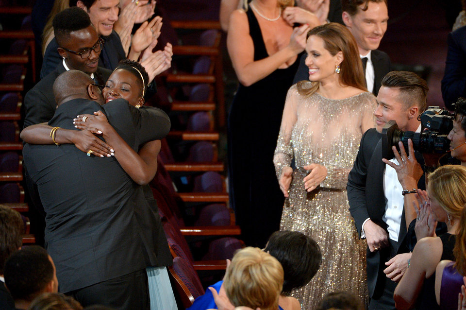 Photo - Steve McQueen, left, and Lupita Nyong'o celebrate in the audience after