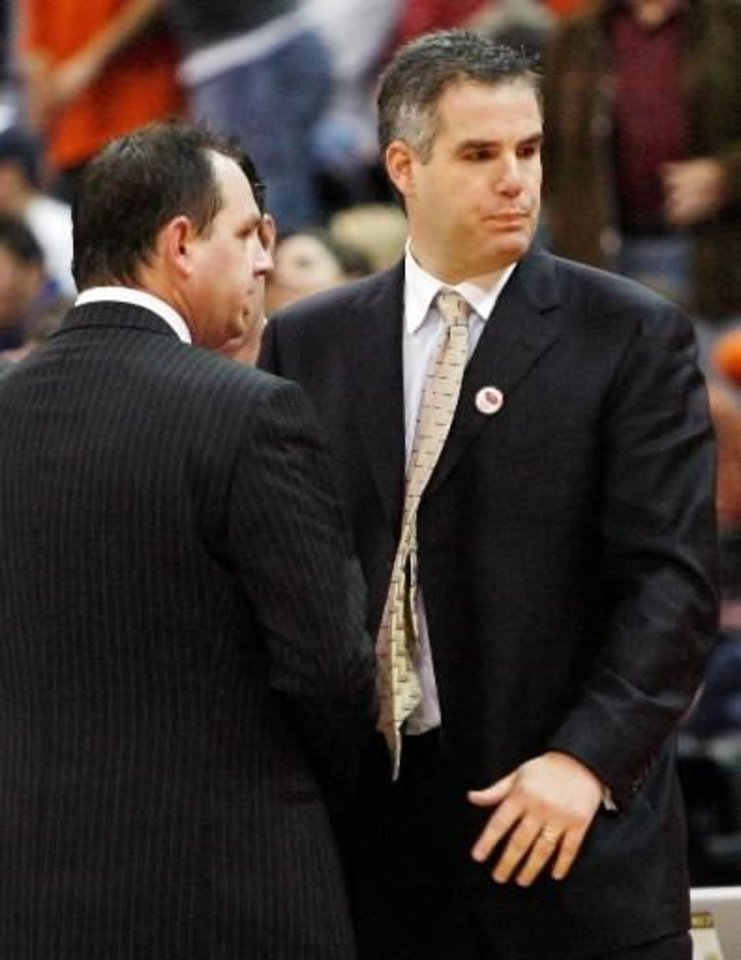 OSU head coach Sean Sutton, left, and ORU head coach Scott Sutton talk after the men's college basketball game between Oral Roberts (ORU) and Oklahoma State (OSU) in the All-College Classic at the Ford Center in Oklahoma City, December 20, 2007. Photo by Nate Billings