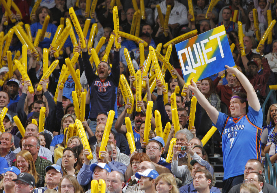 Photo - Thunder fans makes noise on a Kings' free throw attempt during the NBA basketball game between the Oklahoma City Thunder and The Sacramento Kings on Tuesday, Feb. 15, 2011, Oklahoma City Okla.  Photo by Chris Landsberger, The Oklahoman