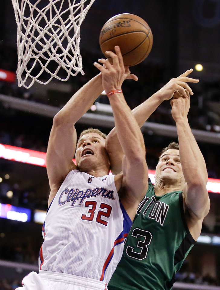 Photo - Los Angeles Clippers forward Blake Griffin, left, is fouled by Boston Celtics forward Kris Humphries during the first half of an NBA basketball game in Los Angeles, Wednesday, Jan. 8, 2014. (AP Photo/Chris Carlson)