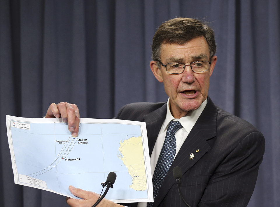 Photo - The chief coordinator of the Joint Agency Coordination Center retired Chief Air Marshall Angus Houston shows a map to the media during a press conference about the on going search operations for wreckage and debris of missing Malaysia Airlines Flight 370 in Perth,  Australia, Monday, April 7, 2014. Houston reported the towed pinger locator deployed from the Ocean Shield has detected two signals consistent with those emitted by an in flight back box recorder, in the northern part of the current search area in the southern Indian Ocean. (AP Photo/Rob Griffith)