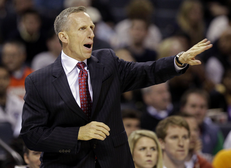 Charlotte Bobcats head coach Mike Dunlap directs his team against the Washington Wizards during the first half of an NBA basketball game in Charlotte, N.C., Tuesday, Nov. 13, 2012. (AP Photo/Chuck Burton)