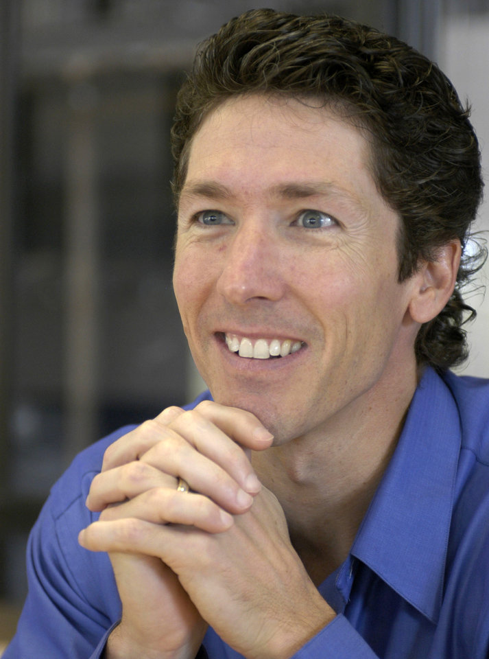 Photo - FILE - Lakewood Church pastor Joel Osteen smiles during an interview in the former basketball arena that has become the new home for the church in Houston, in this  Sept. 20, 2004, file photo. Authorities are investigating after $600,000 in checks and cash was stolen from a safe at Pastor Joel Osteen's Houston megachurch, which has one of the largest congregations in the country. Police spokesman Kese Smith said Tuesday March 11, 2014 $200,000 in cash and $400,000 in checks were stolen from a safe sometime between 2:30 p.m. Sunday and 8:30 a.m. Monday. (AP Photo/Pat Sullivan)