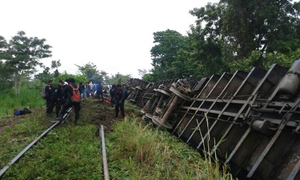 Photo - In this photo release by the Civil Protection of the State of Tabasco, police agents work at a site where a train derailed in Tabasco, Mexico, Sunday, Aug. 25, 2013.  An cargo train known as