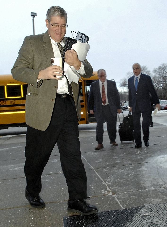 Rep. Todd Porter, R-Mandan, walks outside the North Dakota Capitol building in Bismarck, N.D. on Tuesday, Jan. 8, 2013. Tuesday was the first day of 2013 North Dakota Legislature. Following Porter are Sen. John Warner, D-Ryder, left, and Rep. David Rust, R-Tioga. (AP Photo/Will Kincaid)