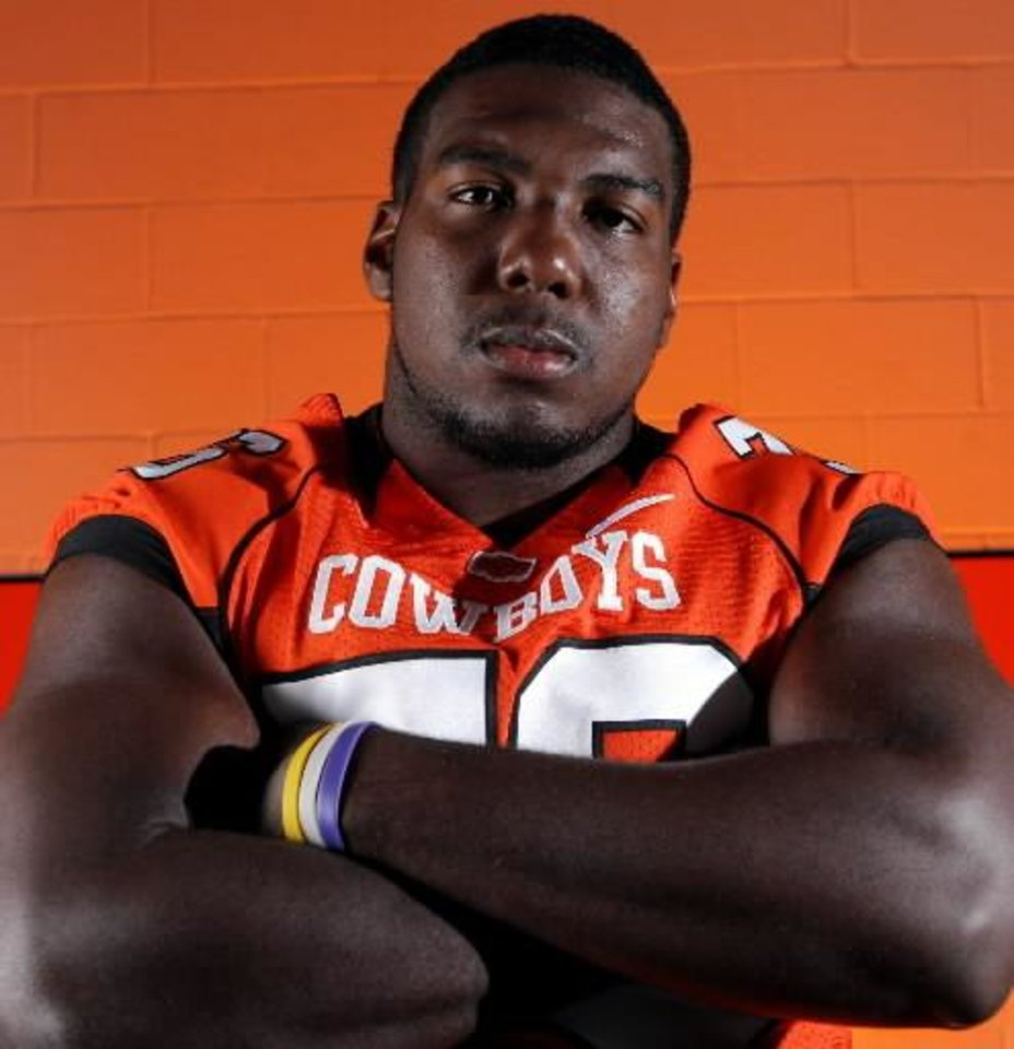 Photo - Offensive lineman  Russell  Okung poses for a photo during Oklahoma State University football media day in Stillwater, Okla., Saturday, August 2, 2008. BY MATT STRASEN