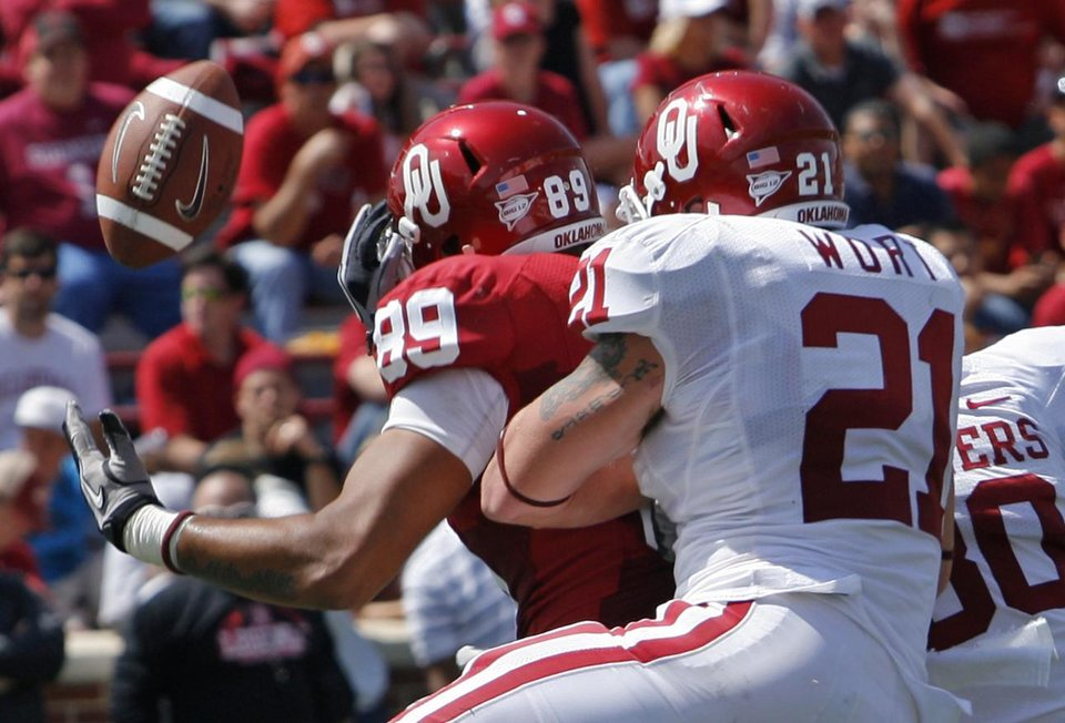 Tom Wort (21) breaks up a pass to Austin Haywood (89) in the end zone during the University of Oklahoma Sooner's (OU) Spring Football game at Gaylord Family-Oklahoma Memorial Stadium on Saturday, April 16, 2011, in Norman, Okla.  