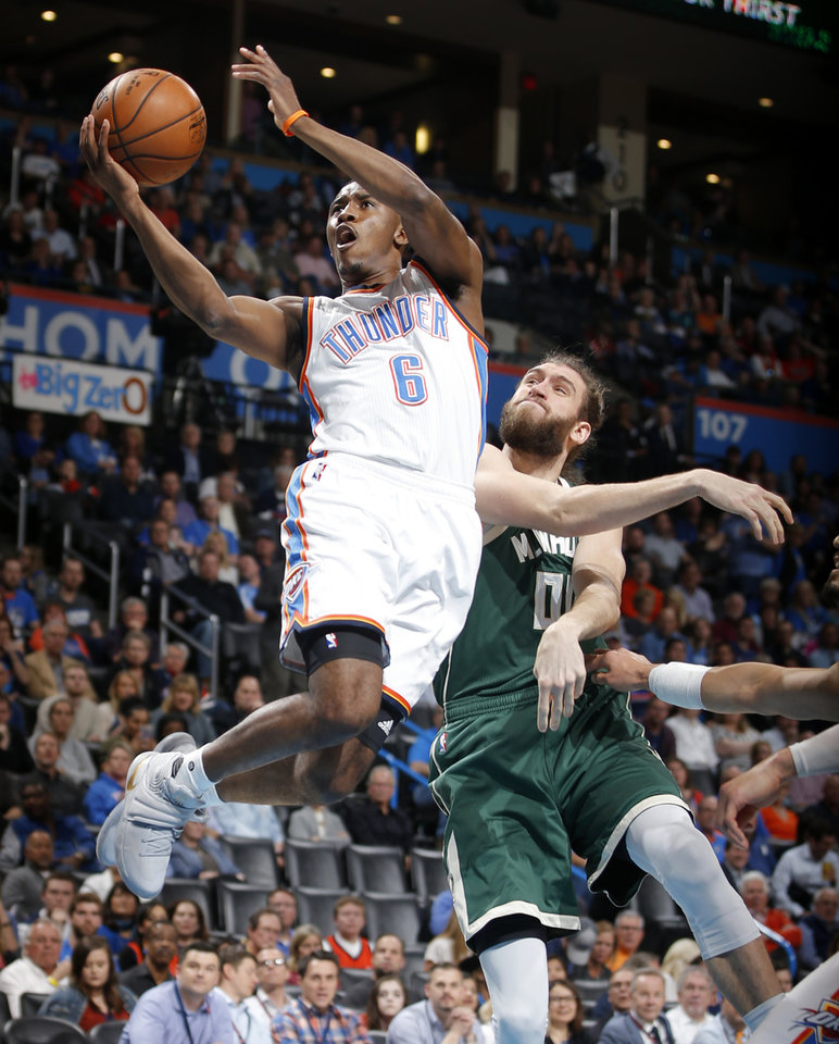 Photo - Oklahoma City's Semaj Christon (6) goes to the bucket past Milwaukee's Spencer Hawes (00) during an NBA basketball game between the Oklahoma City Thunder and the Milwaukee Bucks at Chesapeake Energy Arena in Oklahoma City, Tuesday, April 4, 2017. Photo by Bryan Terry, The Oklahoman