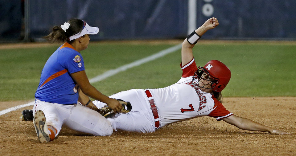 Florida\'s Stephanie Tofft tags Nebraska\'s Jordan Bettiol at third for a double play in the ninth inning of their Women\'s College World Series softball game at ASA Hall of Fame Stadium in Oklahoma City, Saturday, June, 1, 2013. Photo by Bryan Terry, The Oklahoman