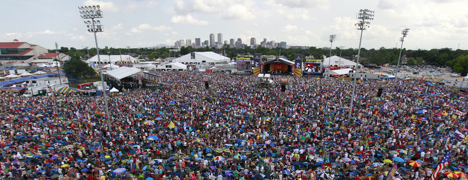 Photo -   Crowds are seen at the New Orleans Jazz and Heritage Festival in New Orleans, Saturday, May 5, 2012. (AP Photo/Gerald Herbert)
