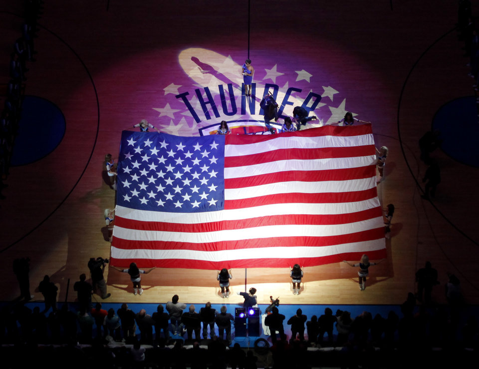 Photo - An American flag is displayed before  the NBA basketball game between the Oklahoma City Thunder and the New Orleans Hornets, Wednesday, Feb. 2, 2011 at the Oklahoma City Arena. Photo by Bryan Terry, The Oklahoman