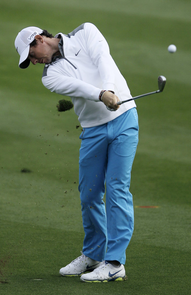 Photo - Rory McIlroy of Northern Ireland plays a ball on the 14t hole during the first round of the Dubai Desert Classic golf tournament in Dubai, United Arab Emirates, Thursday, Jan. 30, 2014. (AP Photo/Kamran Jebreili)