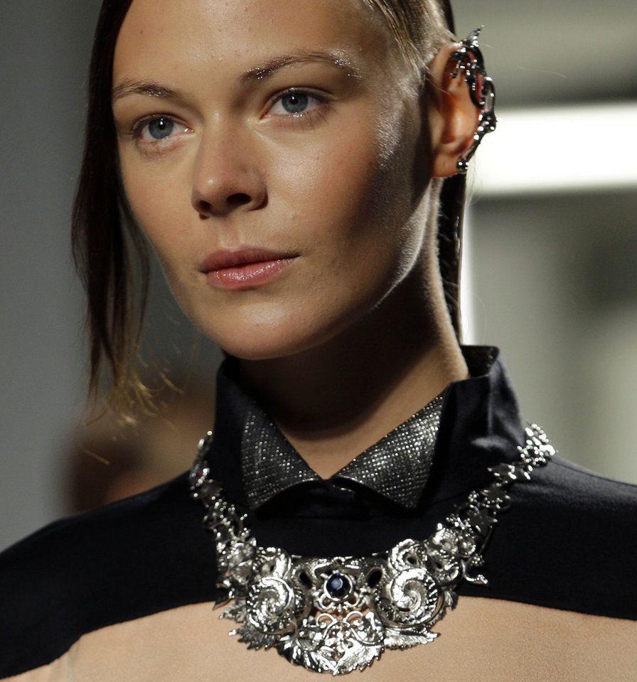 Photo -   FILE - This Sept. 11, 2012 file photo shows a model wearing jewelry during the presentation of the Rodarte Spring 2013 collection at Fashion Week in New York. Tweaking your makeup routine is something you probably could do today because it's changing how you wear the products more than a change in products themselves, says Linda Wells, editor in chief of Allure. (AP Photo/Kathy Willens, file)