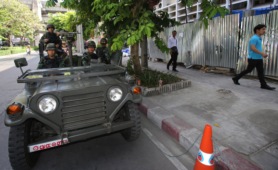 Photo - Thai soldiers guard outside Thai police headquarters Tuesday, May 20, 2014 in Bangkok, Thailand. Thailand's army declared martial law before dawn Tuesday in a surprise announcement it said was aimed at keeping the country stable after six months of sometimes violent political unrest. The military, however, denied a coup d'etat was underway. (AP Photo/Sakchai Lalit)