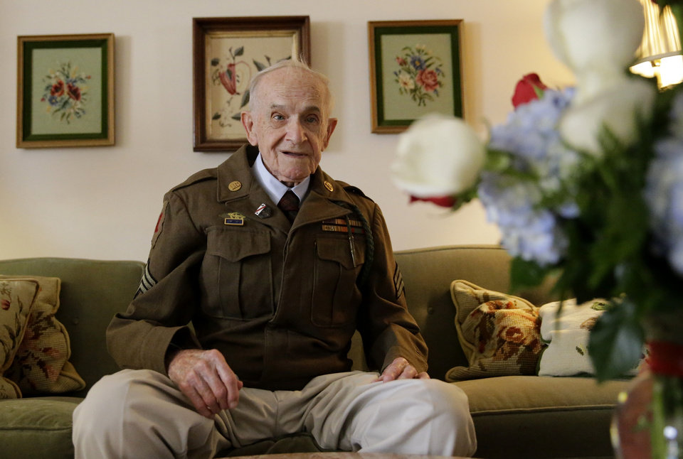 Photo - Eighty-nine-year-old Roland Chaisson, who stormed Normandy on D-Day when Germans killed half his squad before they could reach shore, poses for photographs in his home in Metairie, La., Wednesday, June 4, 2014. Chaisson is among D-Day veterans who will describe that day Friday and Saturday at the National World War II Museum. More than 15 hours of observances are planned Friday, the invasion's 70th anniversary. (AP Photo/Gerald Herbert)