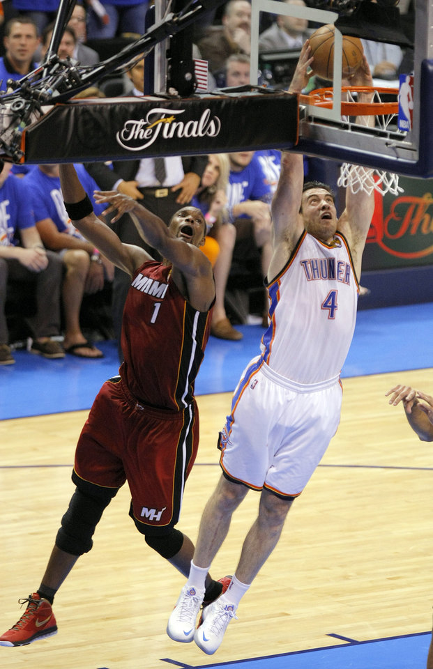 Oklahoma City's Nick Collison (4) dunks in front of Chris Bosh (1) during Game 1 of the NBA Finals between the Oklahoma City Thunder and the Miami Heat at Chesapeake Energy Arena in Oklahoma City, Tuesday, June 12, 2012. Photo by Sarah Phipps, The Oklahoman
