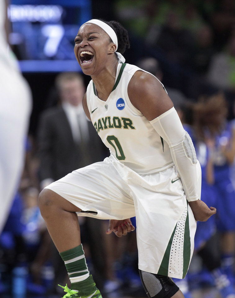 Baylor guard Odyssey Sims celebrates a basket against Kentucky during the first half of a regional semifinal in the NCAA college basketball tournament at the Purcell Pavilion in South Bend, Ind., Saturday, March 29, 2014.  (AP Photo/Paul Sancya)