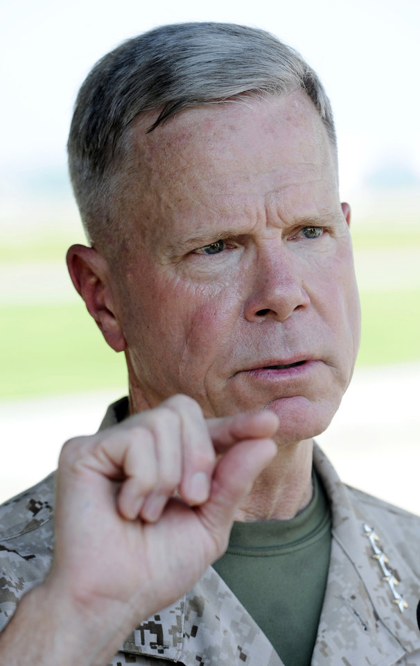 FILE - In this July 29, 2011 file photo, Marine Corps Commandant Gen. James Amos speaks with reporters at Patuxent River Naval Air Station, Md. The Marine Corps commandant said Thursday Jan. 31, 2013, the infantry side is skeptical about how women will perform in those units and some positions may end up being closed if not enough females fail to meet the rigorous standards. (AP Photo/Cliff Owen, File)