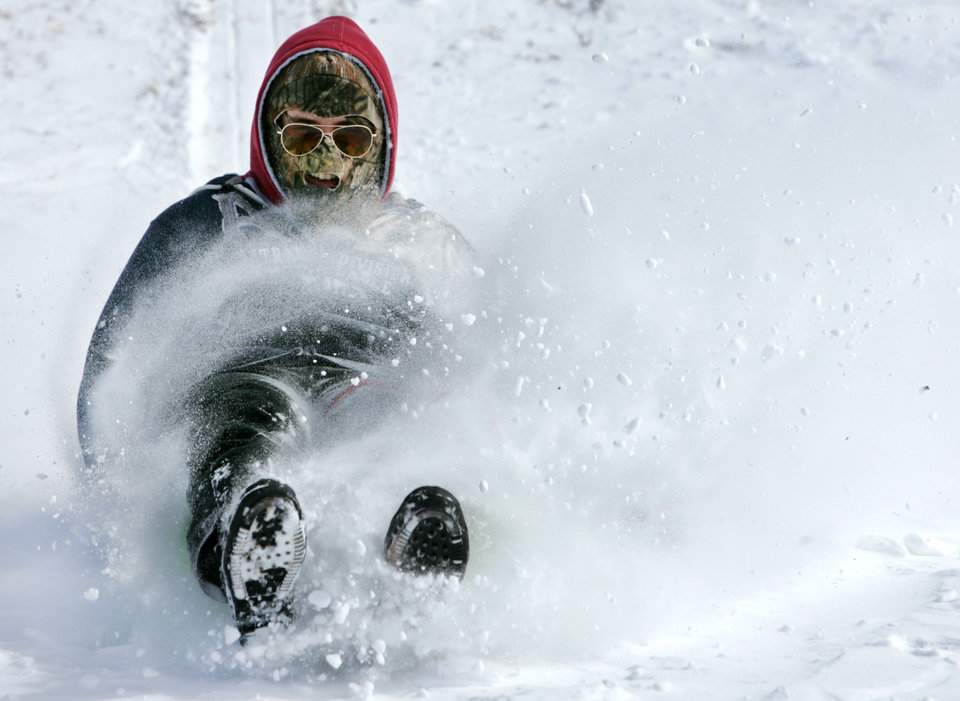 Colton Schroeder, 17 hits a snow drift as he sleds at Will Rogers Park  in Oklahoma City , February  9 , 2011. Photo by Steve Gooch, The Oklahoman