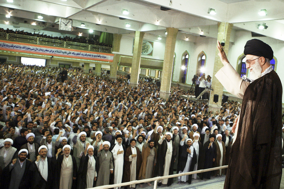 """Iran's supreme leader, Ayatollah Ali Khamenei, waves to people in Tehran on Monday as they chant slogans during a ceremony to commemorate a Shiite saint. Khamenei warned Western governments Monday of a """"negative impact"""" on relations because of what he called their meddling in the country's post-election riots, Iranian television reported. AP PHOTO"""