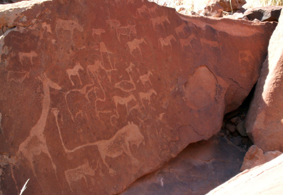 Photo - This June 17, 2014 photo shows etchings left by the nomadic San people at Twyfelfontein, a national monument in Namibia. The site is near Damaraland Camp, a joint venture of the local community and a safari company in northwest Namibia. (AP Photo/Donna Bryson)