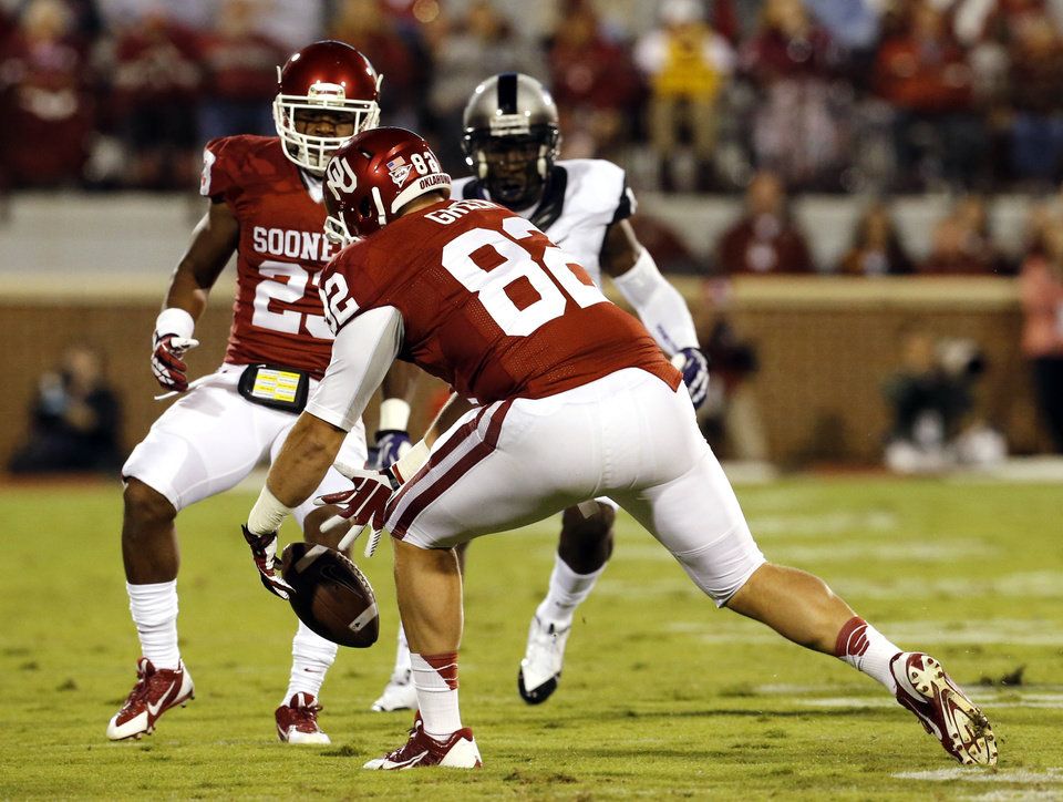 Photo - Oklahoma's Brannon Green loses a TCU kickoff that is recovered by TCU during the second half of a college football game between the University of Oklahoma Sooners (OU) and the TCU Horned Frogs at Gaylord Family-Oklahoma Memorial Stadium in Norman, Okla., on Saturday, Oct. 5, 2013. Photo by Steve Sisney, The Oklahoman