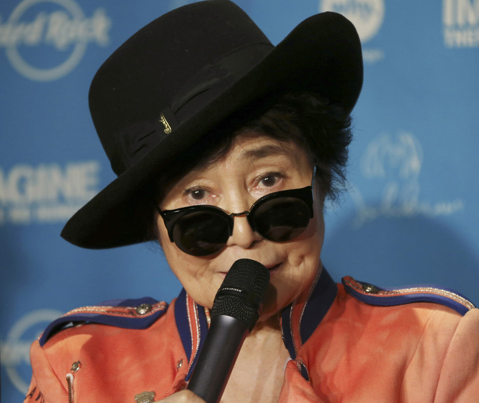 Photo - Yoko Ono speaks during a campaign to fight childhood hunger around the world, in Tokyo Thursday, Dec. 5, 2013. The 80-year-old widow of John Lennon said that she believes he would be happy to see his song