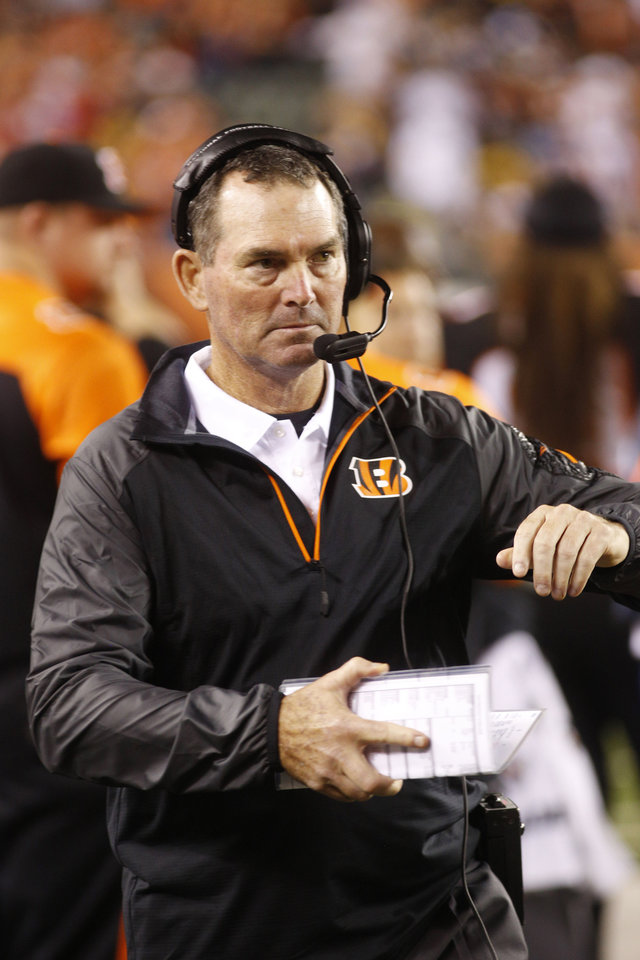 Photo - FILE - IN this Sept. 17, 2013 file photo, Cincinnati Bengals defensive coordinator Mike Zimmer watches from the sidelines in the second half of an NFL football game against the Pittsburgh Steelers, in Cincinnati. The Minnesota Vikings have chosen  Zimmer as their new head coach, according to multiple media reports. Zimmer will replace Leslie Frazier, who was fired after the team finished 5-10-1 this season. (AP Photo/David Kohl, File)