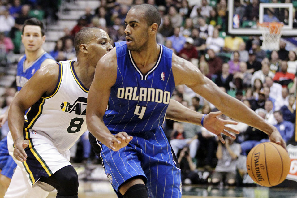 Utah Jazz point guard Randy Foye (8) reaches for a steal as Orlando Magic forward Arron Afflalo (4) dribbles in the second quarter during an NBA basketball game, Wednesday, Dec. 5, 2012, in Salt Lake City. (AP Photo/Rick Bowmer)