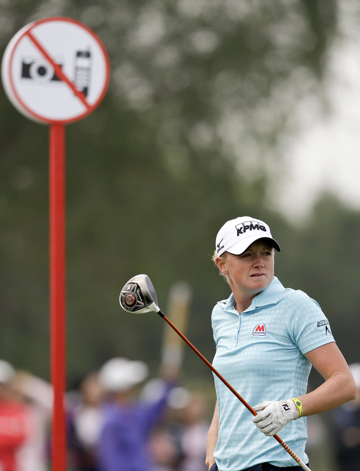 Stacy Lewis of the United States follows her ball after teeing off on the forth hole during the final round of the Reignwood LPGA Classic golf tournament at Pine Valley Golf Club on the outskirts of Beijing, China, Sunday, Oct. 6, 2013. (AP Photo/Alexander F. Yuan)