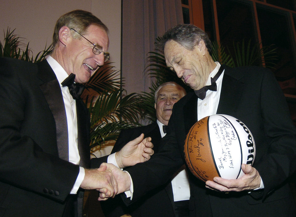 Photo - OKLAHOMA CITY, OKLA., FRIDAY, APRIL 23, 2004. DEAN A. McGEE AWARDS CEREMONY. Burns Hargis, left, laughs as he received an autographed Final Four basketball from Oklahoma State University basketball coach Eddie Sutton, right, during a presentation at the Dean A. McGee Awards ceremony, Friday night, April 23, 2004. Staff Photo by Bryan Terry.