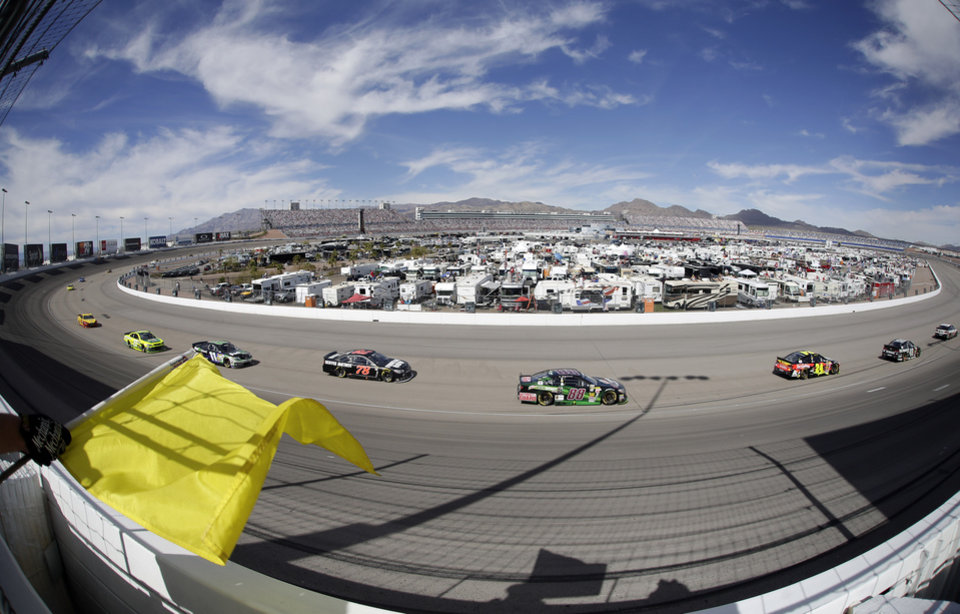 Photo - Dale Earnhardt Jr. (88) drives during a caution at a NASCAR Sprint Cup Series auto race Sunday, March 9, 2014, in Las Vegas. (AP Photo/Isaac Brekken)