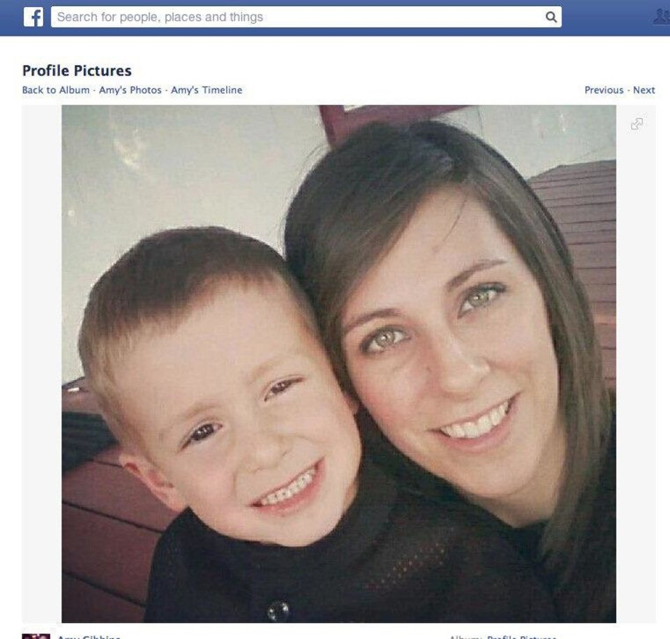 Photo - This photo shows Amy Gibbins, 22, and her son Bryor. They were found dead in June 16 after their home was destroyed by a fire in Calumet. Facebook photo